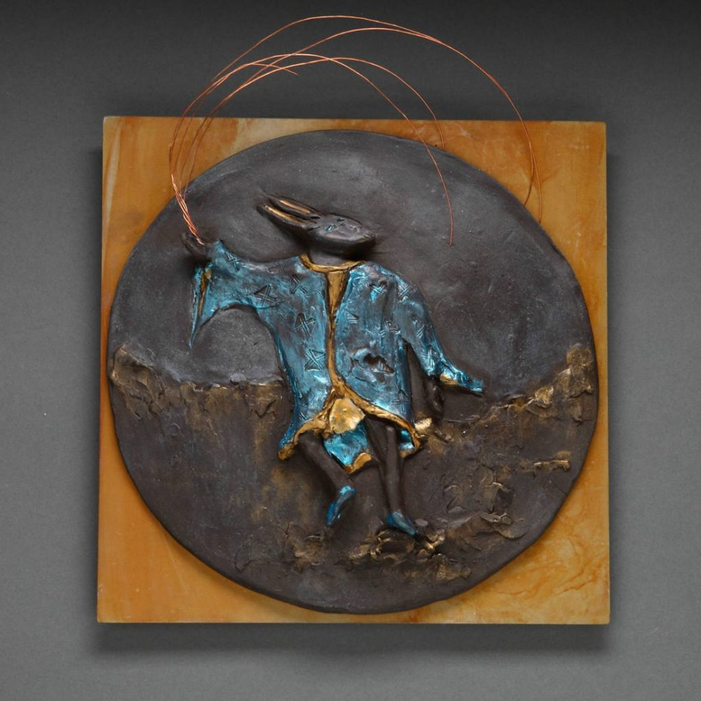 gzipperer_Ninja Rabbit Catches the Light_Clay on patinaed steel with mixed media enhancements_12w X 12h X 3d